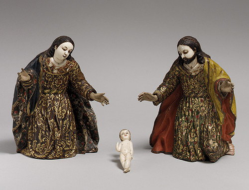 The ivory heads of Mary and Joseph were among the numerous such parts imported to America via the Manila Galleon trade. The style of the figures' polychromy, however, reveals that they were set into their wooden bodies in Ecuador. Artists there practiced a distinctive technique to embellish the garments of their sculptures, applying gold patterns over the colored backgrounds rather than scratching them through, as in true estofado.